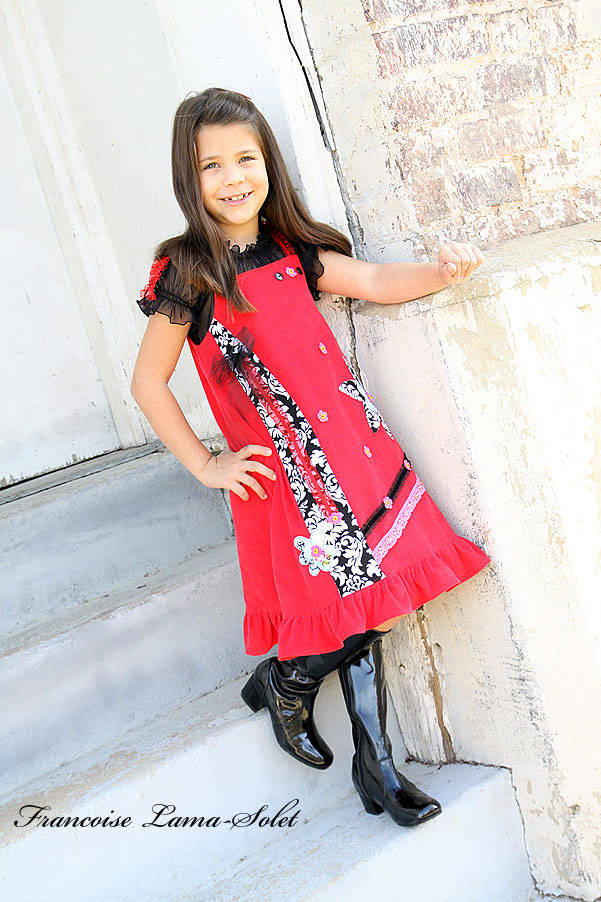 Red corduroy ruffled jumper dress embellished with flowers, black trims and appliques Art Studio