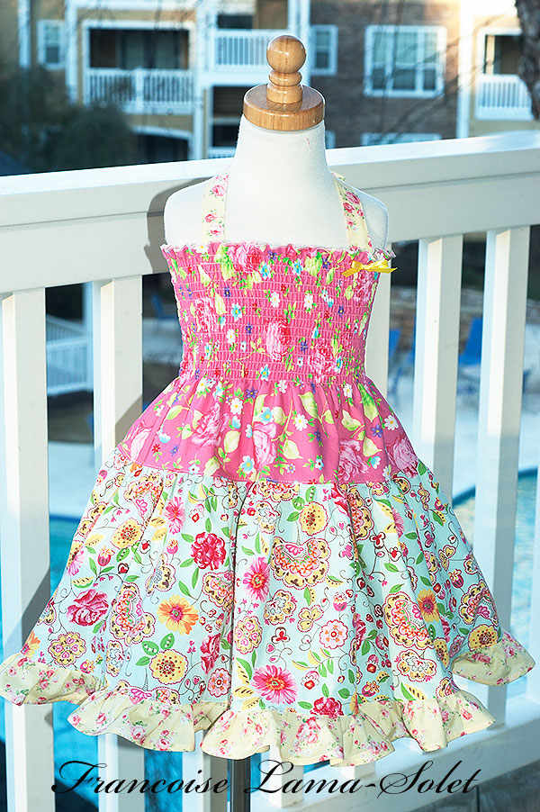 Girl's one of a kind ruffled tiered twirl dress handmade with pink, blue and yellow prints Candice