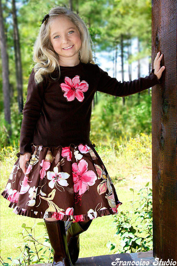 Girl's fall winter casual set composed of a brown, pink long sleeve t-shirt and a floral ruffled skirt Chocolate Flavor